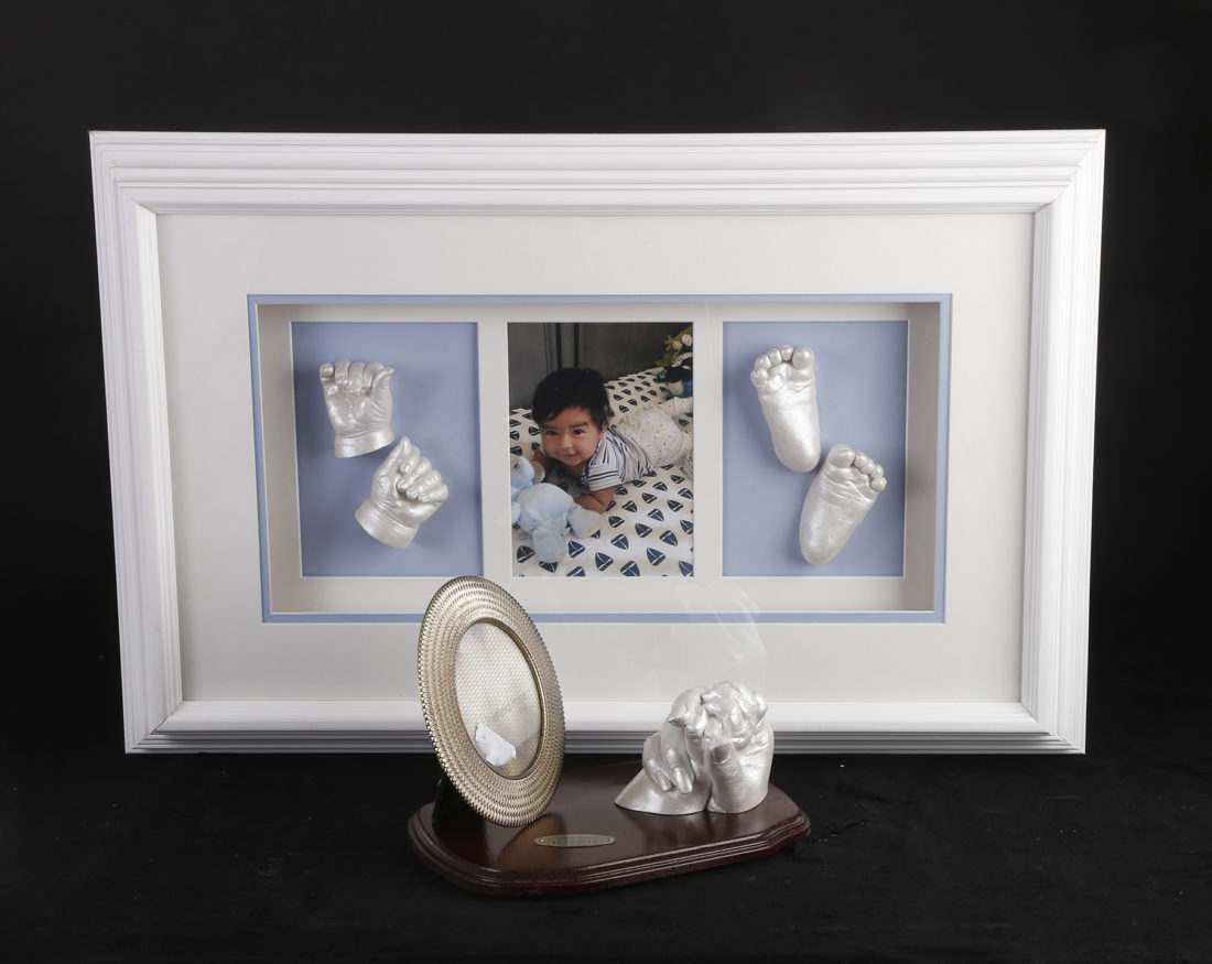 Baby casting white frame : mother and child